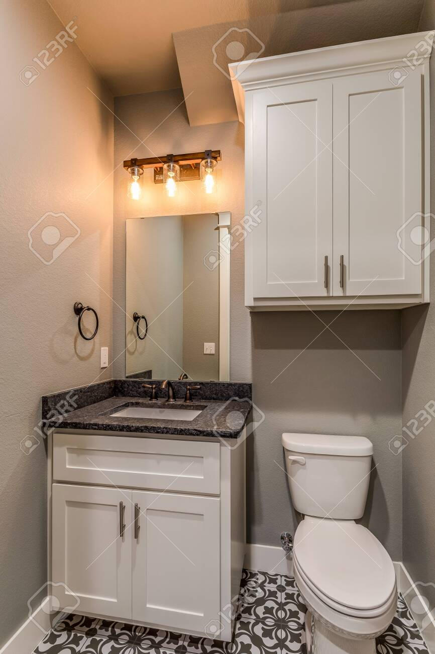 modern unique pattern tile in this small half bath