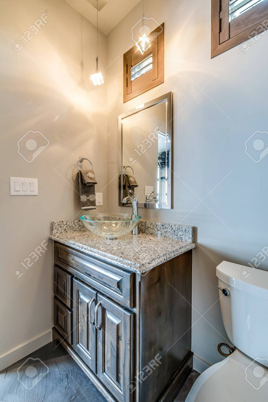 small bathroom with clear vessel sink