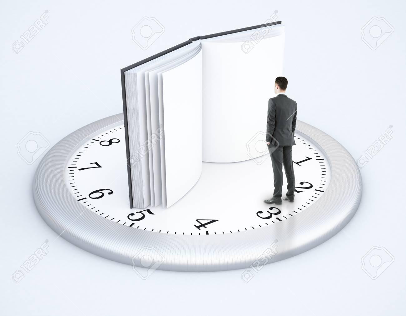 banque d images homme d affaires minuscule debout sur l horloge avec un livre ouvert au lieu de fleches sur fond clair rendu 3d