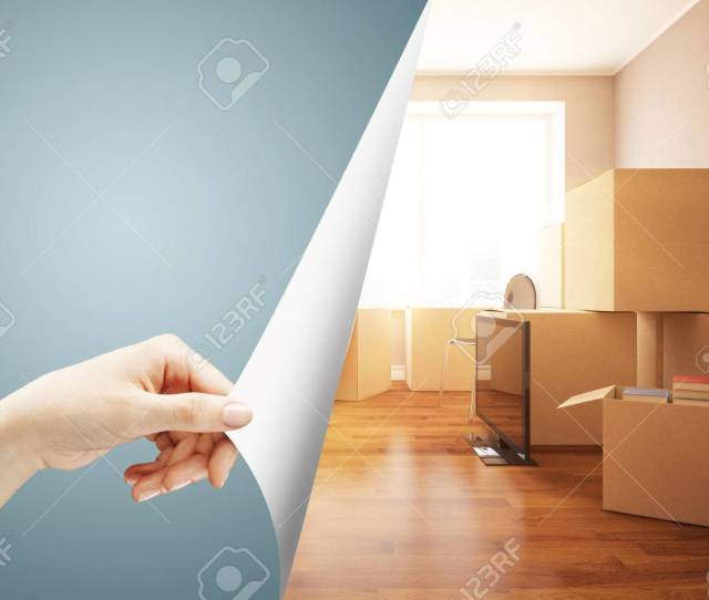Girls Hand Flipping Abstract Grey Page Revealing New Room With Moving Boxes Repairs Concept