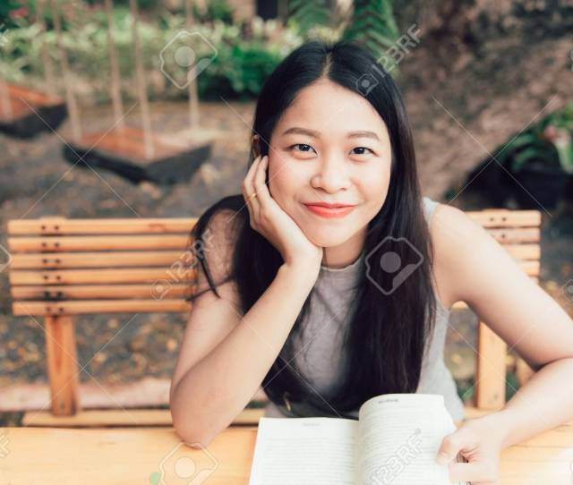 Enjoy Relax Times With Reading Book Asian Women Thai Teen Smile With Book In Coffee