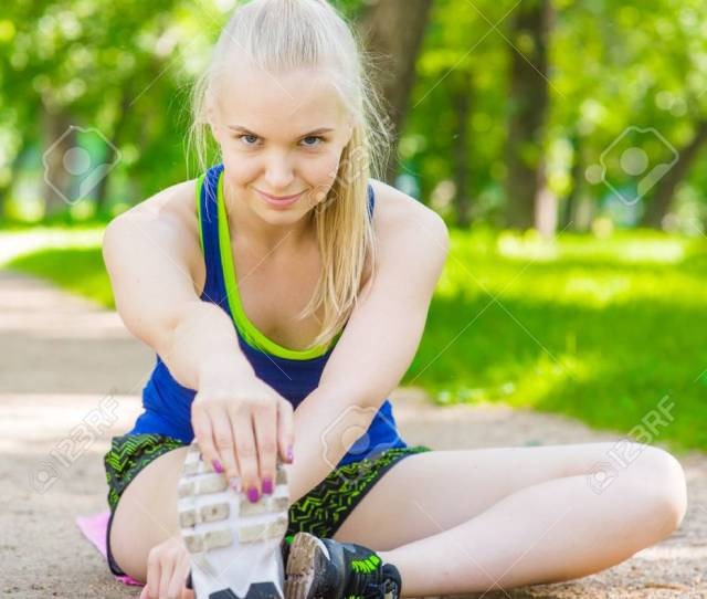 Happy Teen Girl Stretching Legs Before Run Stock Photo 60188084