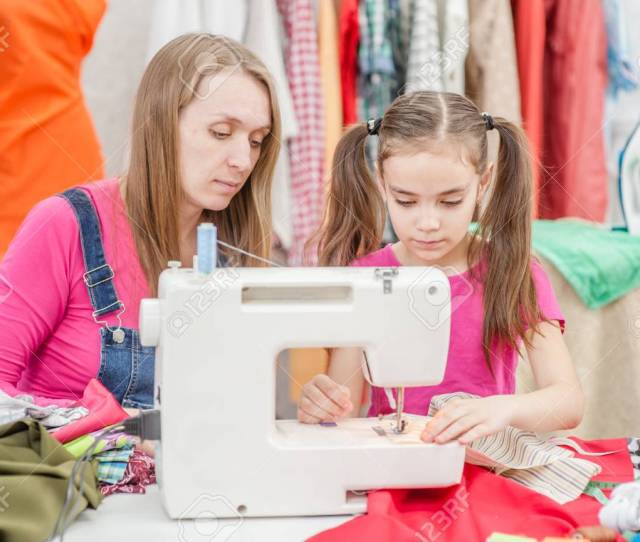 Mom Teaches A Little Girl To Sew On A Sewing Machine Stock Photo 104294363