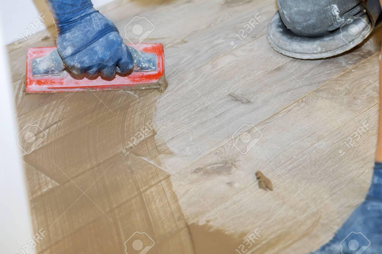 https www 123rf com photo 138690547 builder applying grouting on shower tiles in bathroom gray cement mortar html