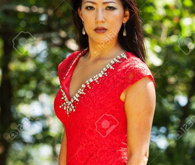 Mature Asian Woman With Red Dress Stock Photo 59668399