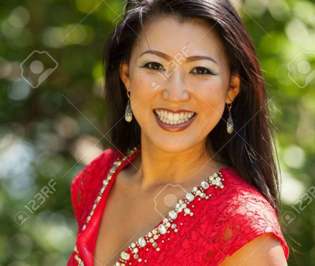 Mature Asian Woman With Red Dress Stock Photo 59668406
