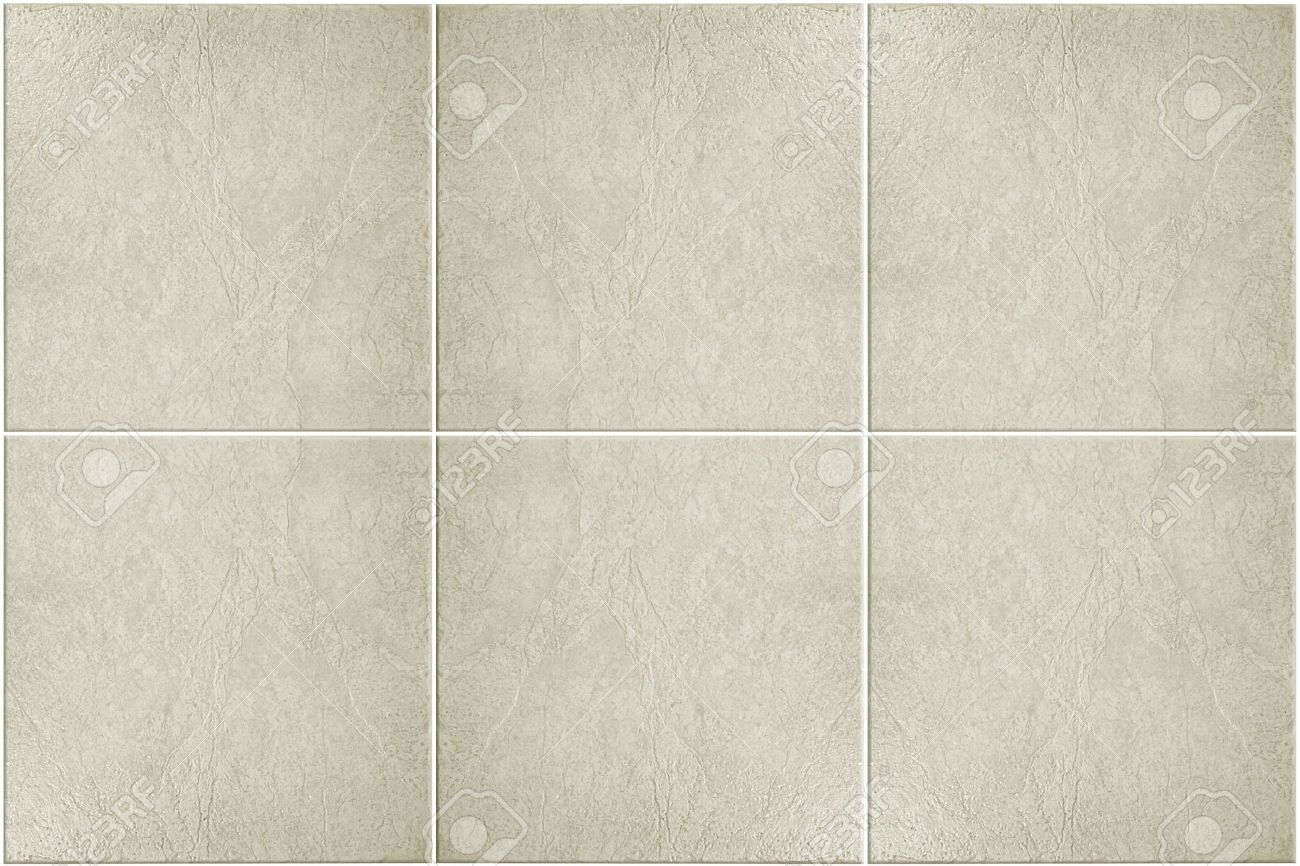 neutral colored floor tile with white grout