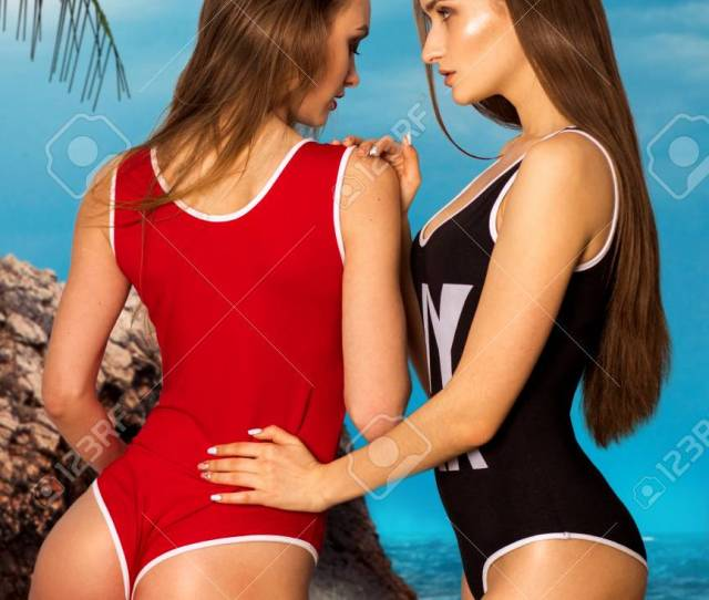 Stock Photo Two Hot Girls Posing On The Beach In Body Swimsuit