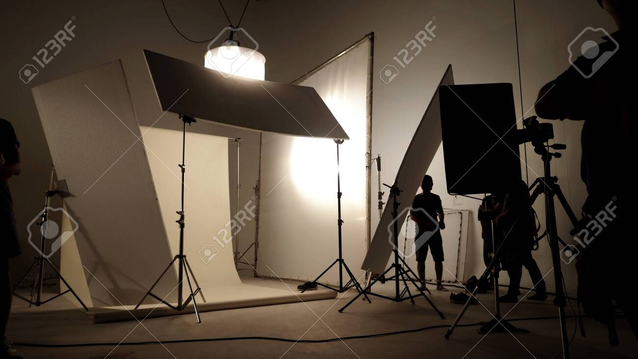 silhoutte images of video production and lighting set for filming
