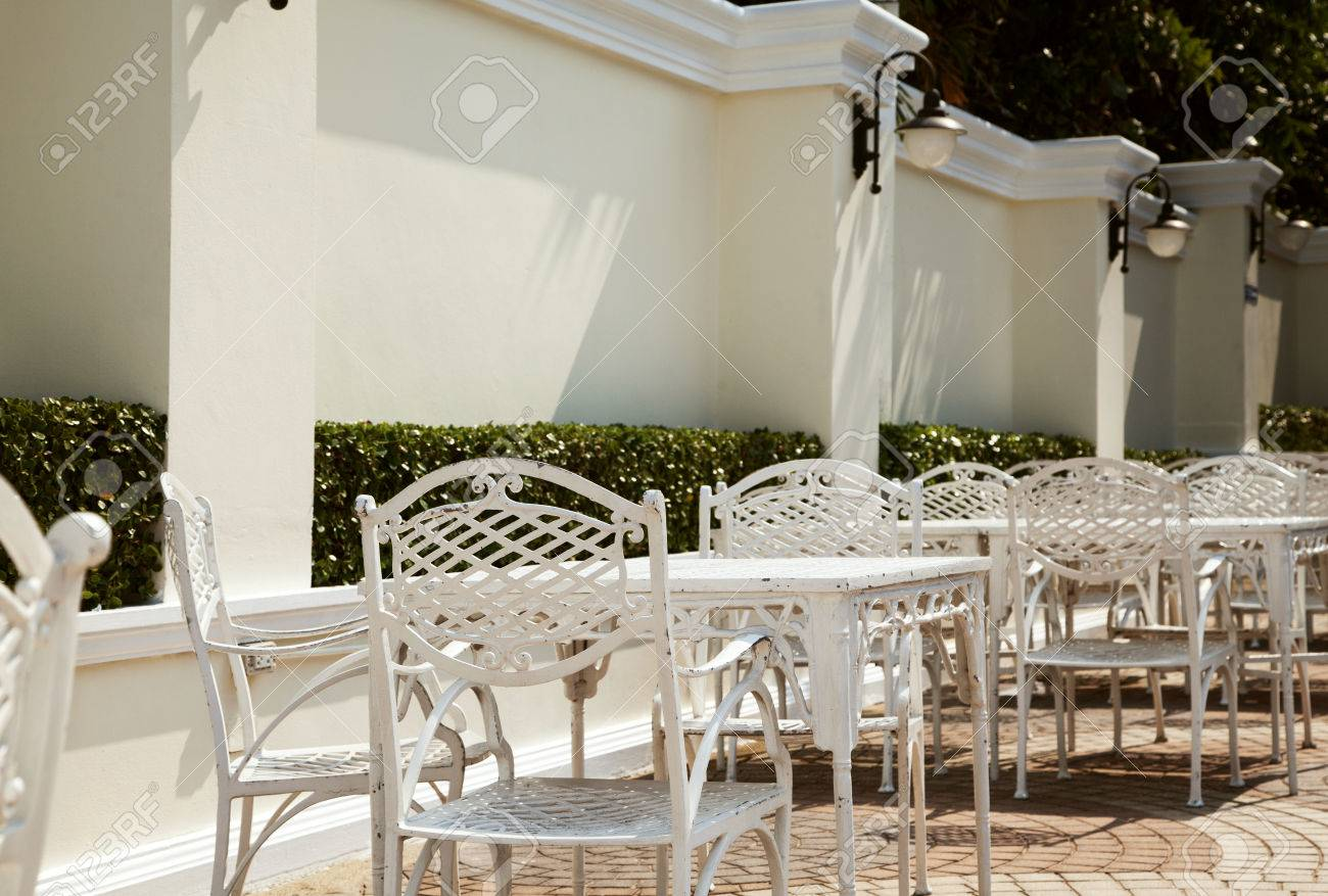 empty outdoor cafe at hotel wrought iron furniture row of stock photo picture and royalty free image image 68576467