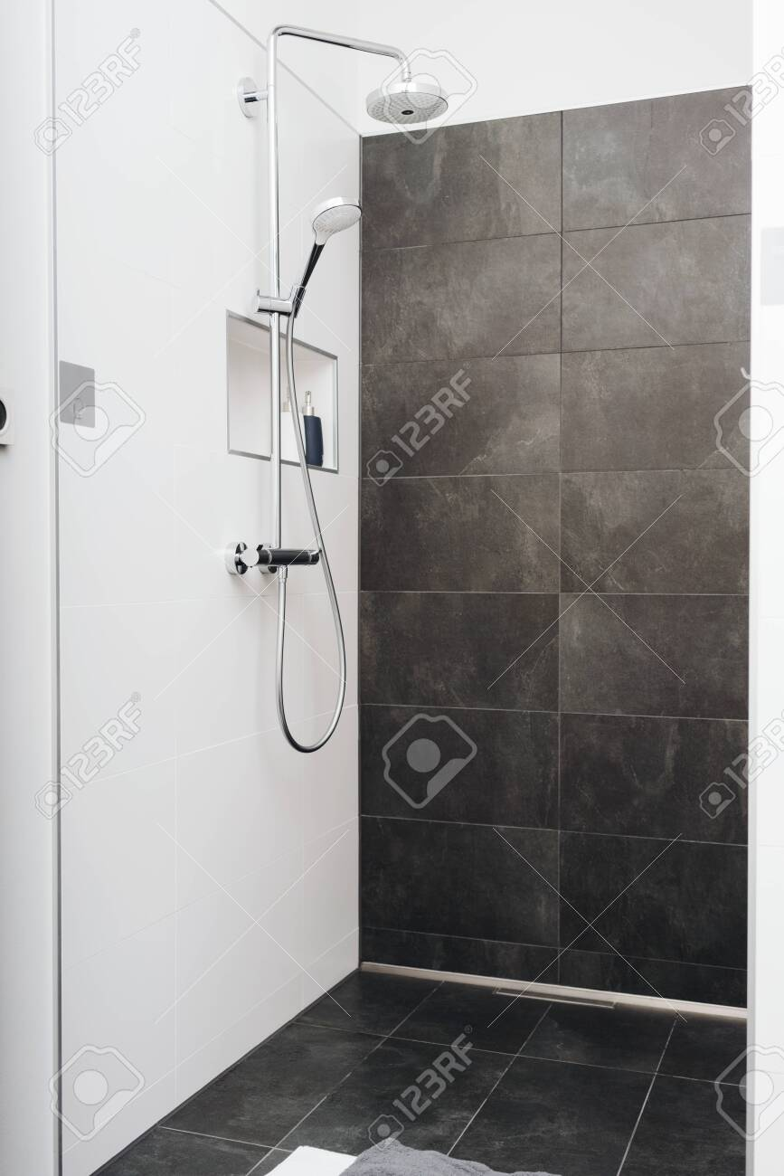 modern empty clean shower cubicle with glass door and grey tiles stock photo picture and royalty free image image 121967973
