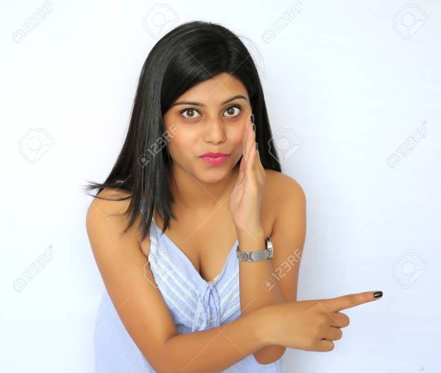 A Young Sexy Indian Girl Pointing Her Finger Isolated On A White Background Stock Photo