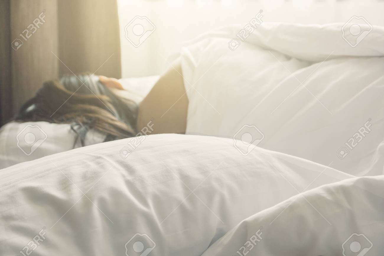 wrinkle messy blanket and white pillow in bedroom with blur image