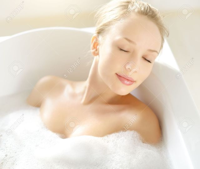 Attractive Girl Relaxing In Bath On Light Background Stock Photo 17803567