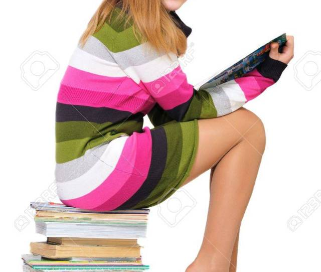 Stock Photo Sweet Teen Girl Sitting On The Pile Of Books