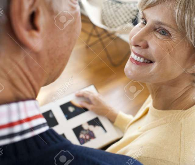 Rear View Of Mature Couple With Photo Album Stock Photo 88380222