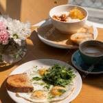 Tasty Healthy Breakfast Fried Eggs Salmon Arugula And Croutons Stock Photo Picture And Royalty Free Image Image 141689992
