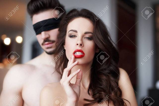 Passionate Sensual Woman With Red Lips In Hotel Room With Lover Couple Foreplay Stock Photo