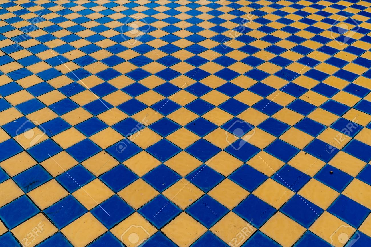 perspective of old style blue and yellow ceramic tiles floor