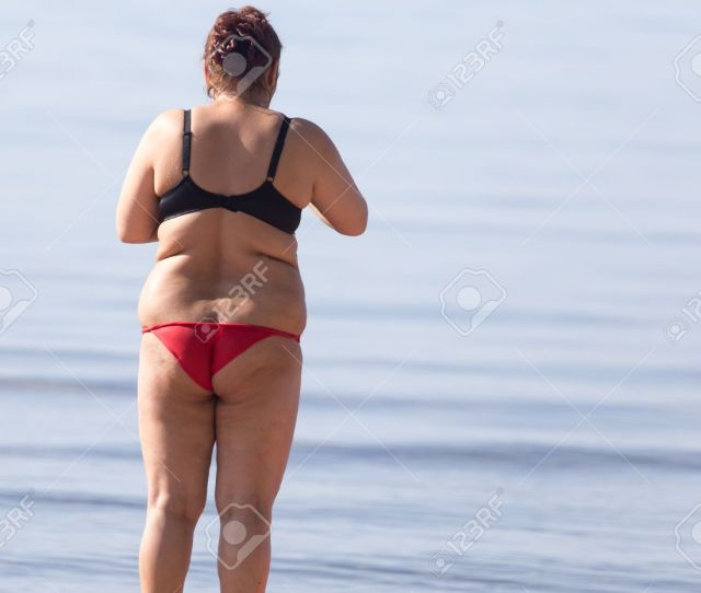 Fat Woman On The Beach Stock Photo