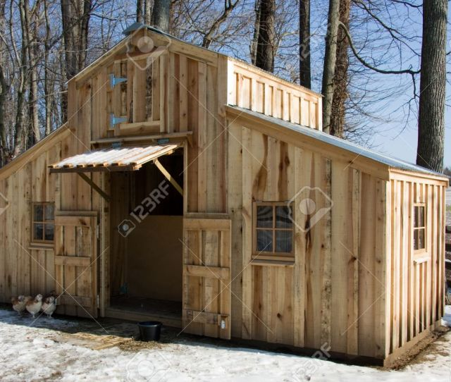 A Small Homemade Barn Made Of Rough Cut Poplar Sits Among The Trees During