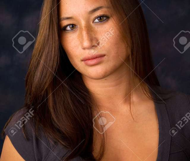 Attractive Sexy Asian American With Freckled Face Wears A Low Cut Dress Stock Photo
