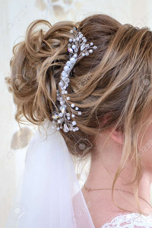wedding hairstyle for long blonde hair with a beautiful ornament..