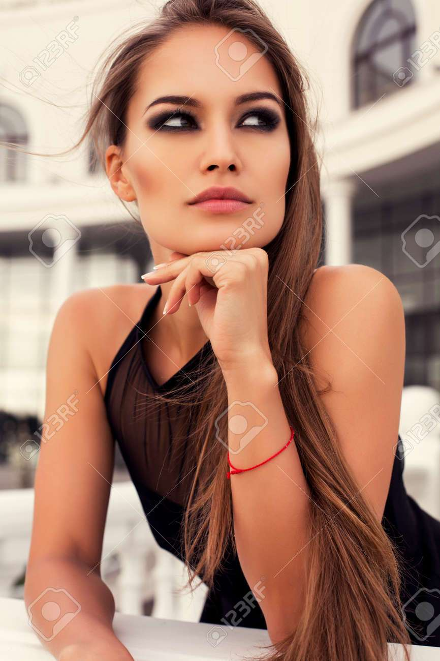 fashion photo of beautiful glamour model with long straight hair