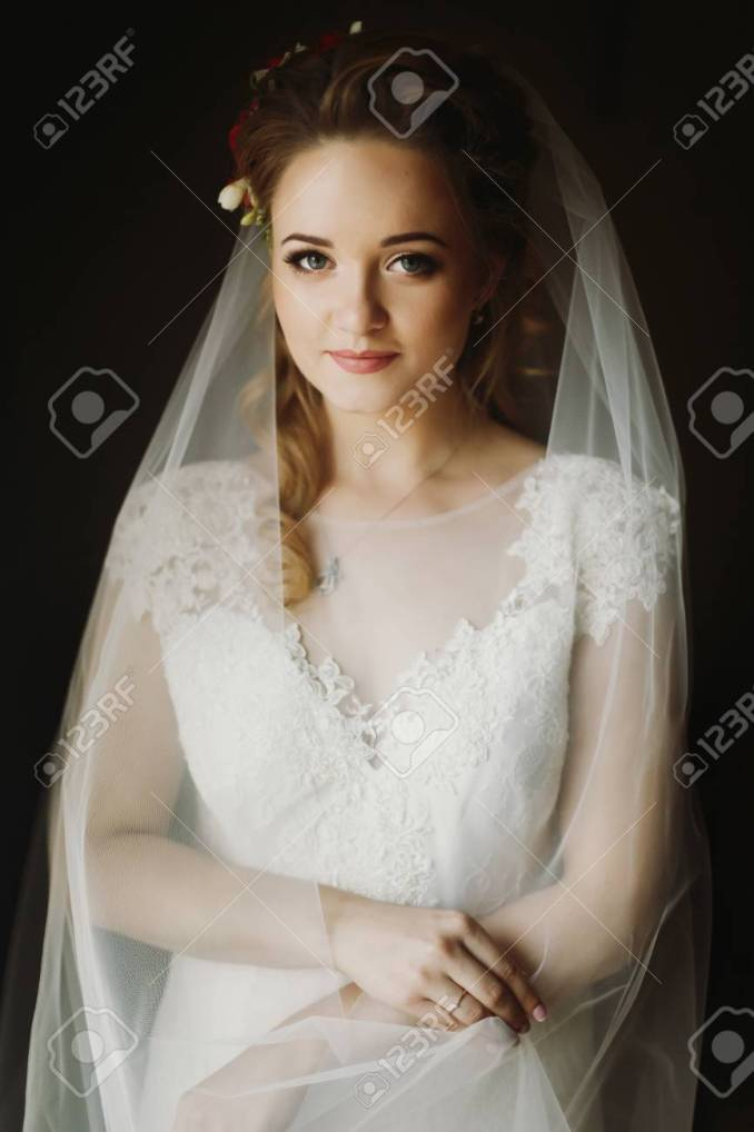 portrait of beautiful bride, blonde bride in elegant white wedding..