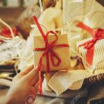 Hand Giving Stylish Rustic Christmas Gift Box Under Christmas Stock Photo Picture And Royalty Free Image Image 107858644