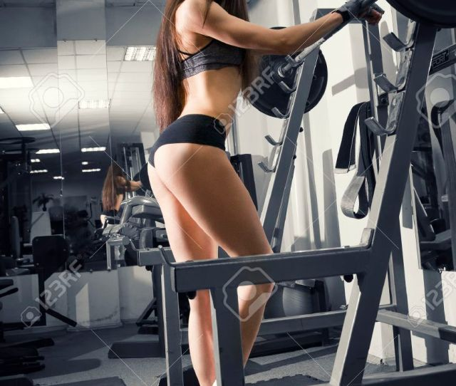 Stock Photo Young Sexy Fitness Girl Workout With Barbell In The Gym Woman In Sport Wear With Perfect Muscular Body Black And White Background