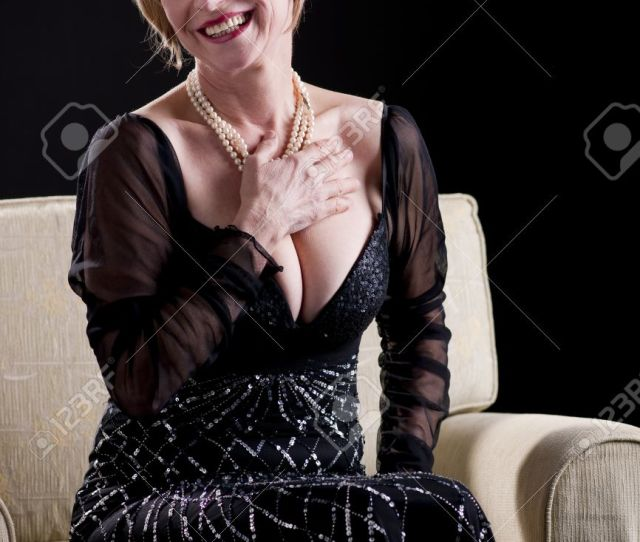 Portrait Of A Mature Woman In Evening Gown Stock Photo