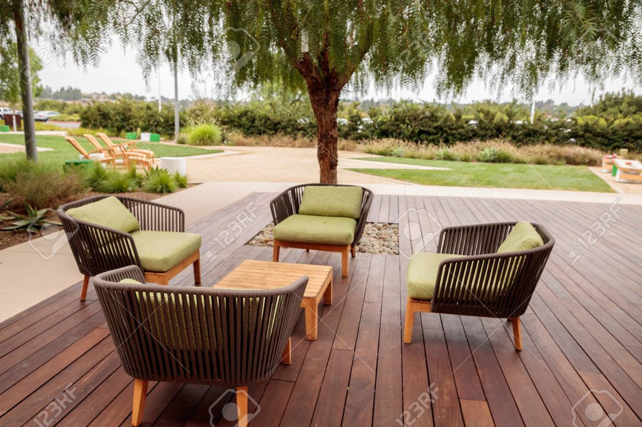 https www 123rf com photo 85755767 wood patio lounge chairs with green cushions in the backyard with green grass in the summer html