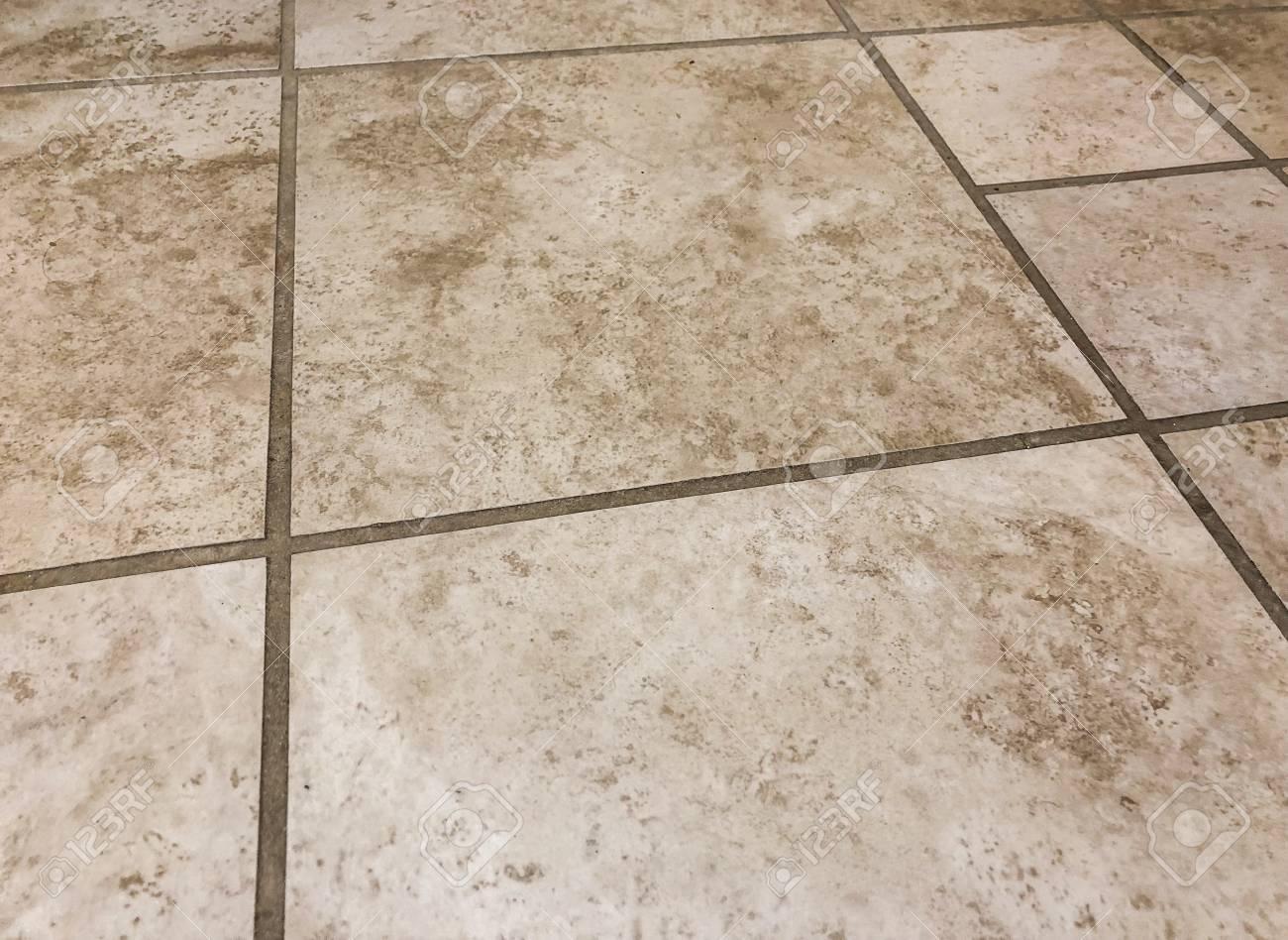 granite brown and beige square tiles plased horisontal in straght