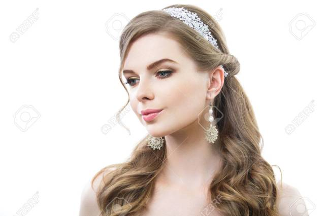 beautiful woman with long curly hair. on her white earrings and..