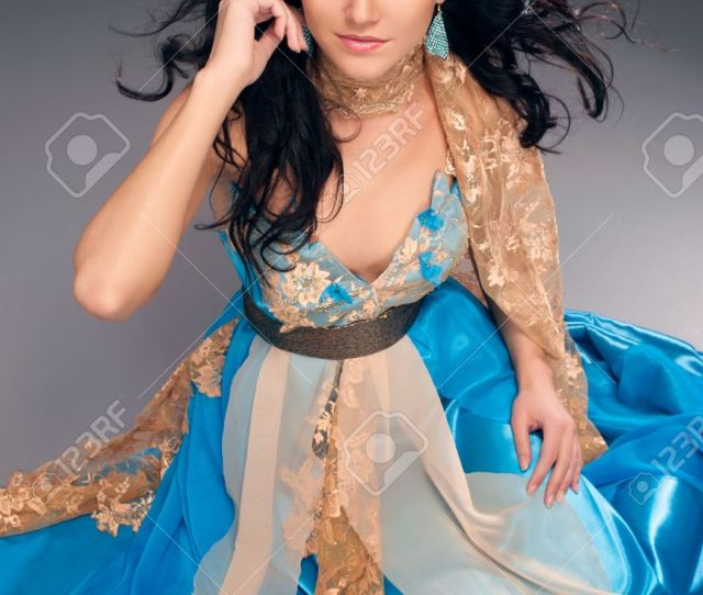 Beautiful Indian Girl In A Blue Dress Sitting On The Floor Stock Photo 21301224