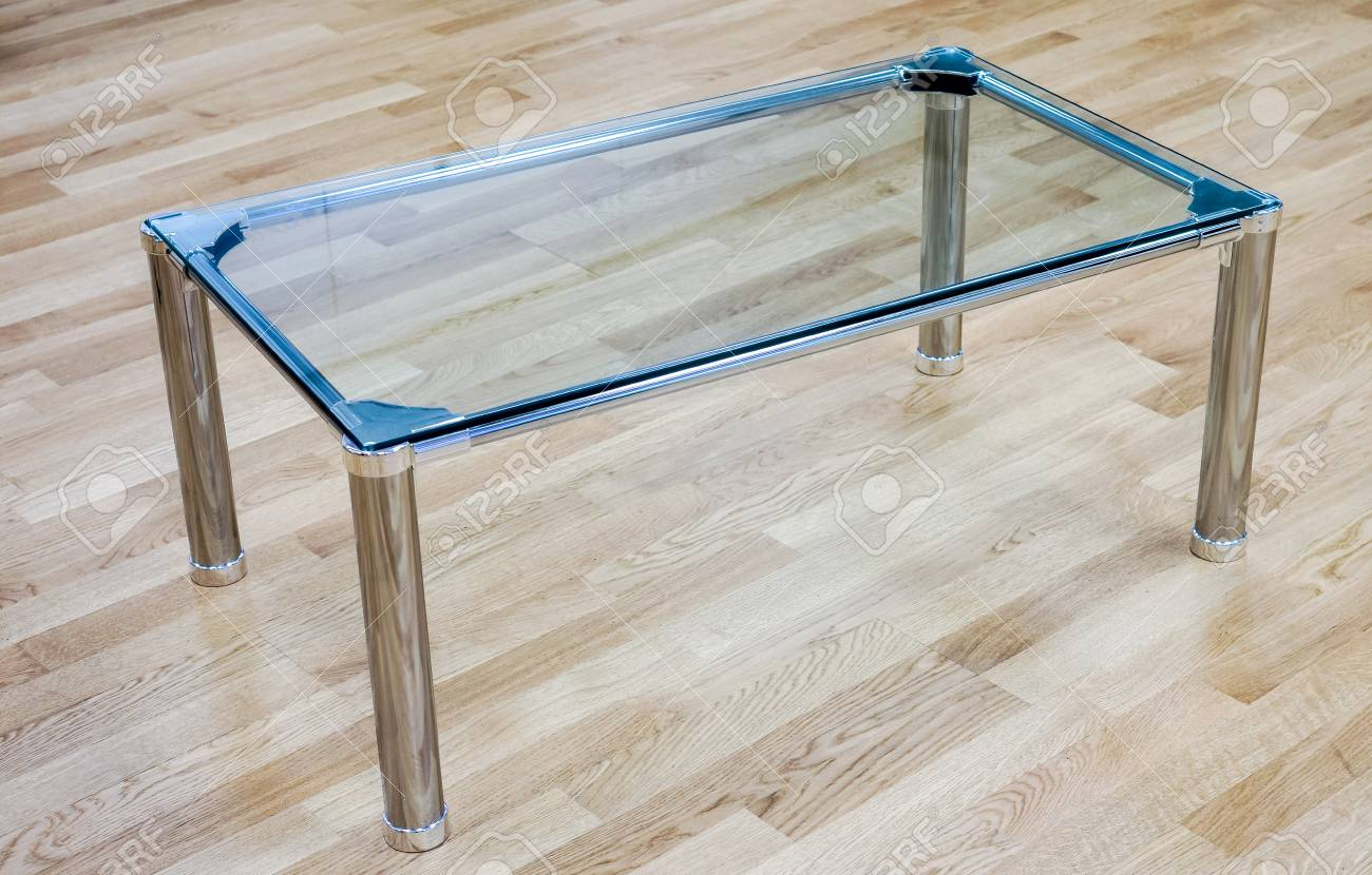 office glass table against wooden floor clear glass small table