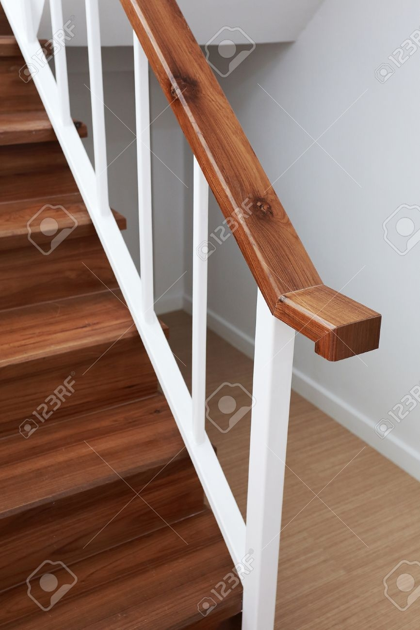 Wooden Staircase Railing In A White Modern House Stock Photo | Modern Wood Stair Railing | Creative Outdoor Stair | Traditional | Indoor | Balustrade | Cherry Wood