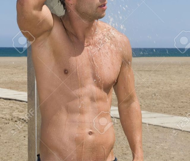 Sexy Man Taking A Shower In The Beach Under The Blue Sky Stock Photo 3452591