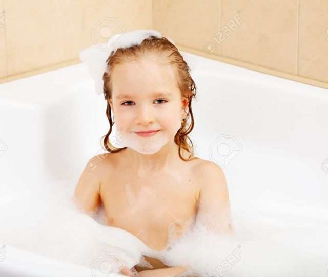 Child In The Bathtub Girl Washes In The Bathroom Stock Photo 16165637