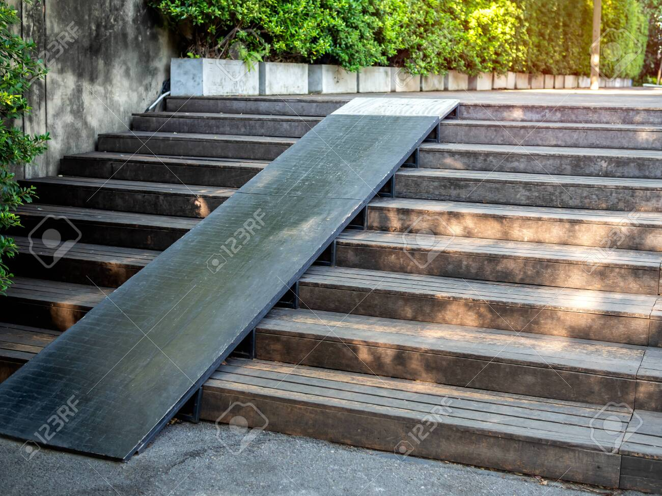 Plank Wood Stair Outdoor With Wooden Wheelchair Ramp On Green