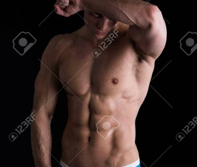 Attractive Young Man Standing With Naked Muscular Ripped Body Wiping Sweat Off Forehead Stock Photo