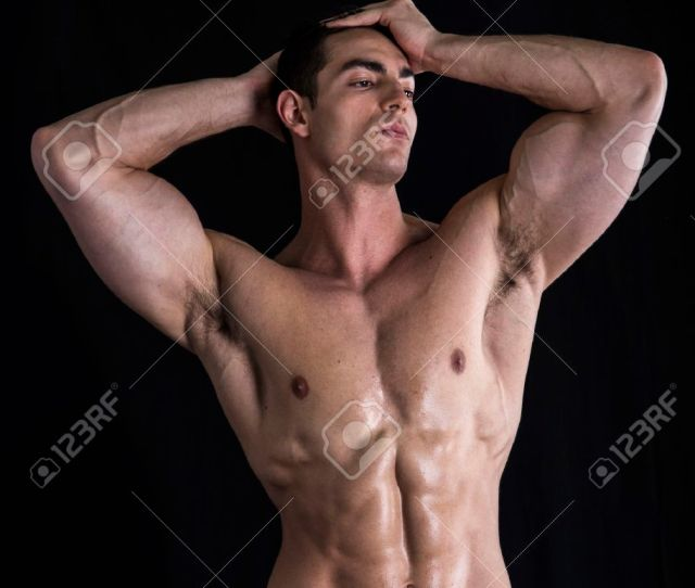 Attractive Young Man Standing With Naked Muscular Ripped Body Hands On Head Stock Photo