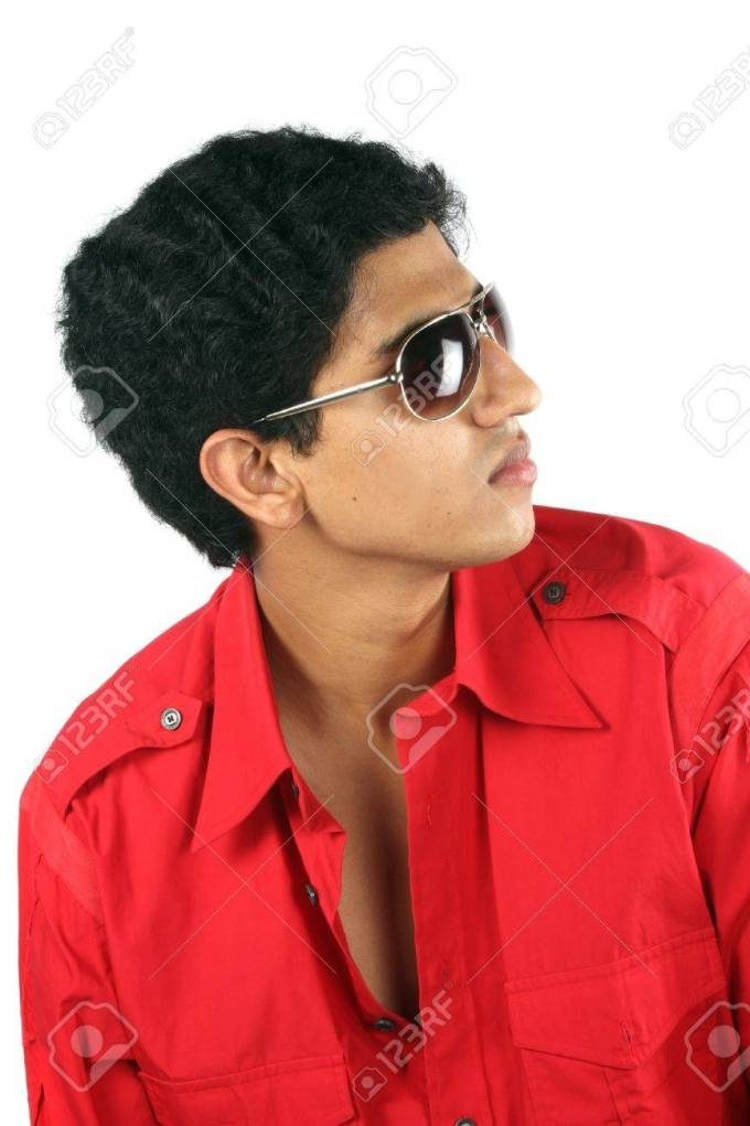 a portrait of a handsome indian teenage guy, on white studio..