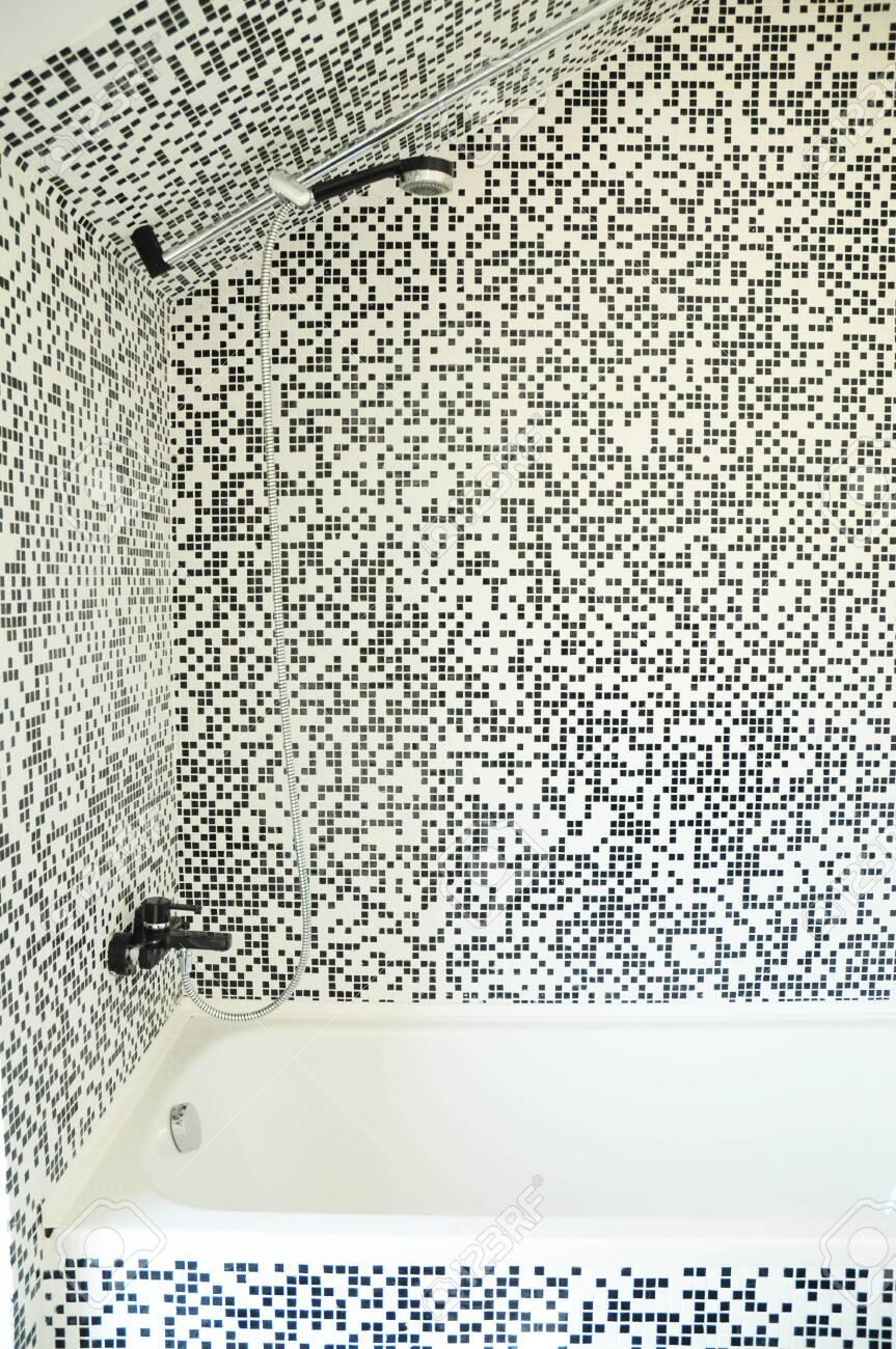 modern bath tub with shower chrome faucet and modern mosaic