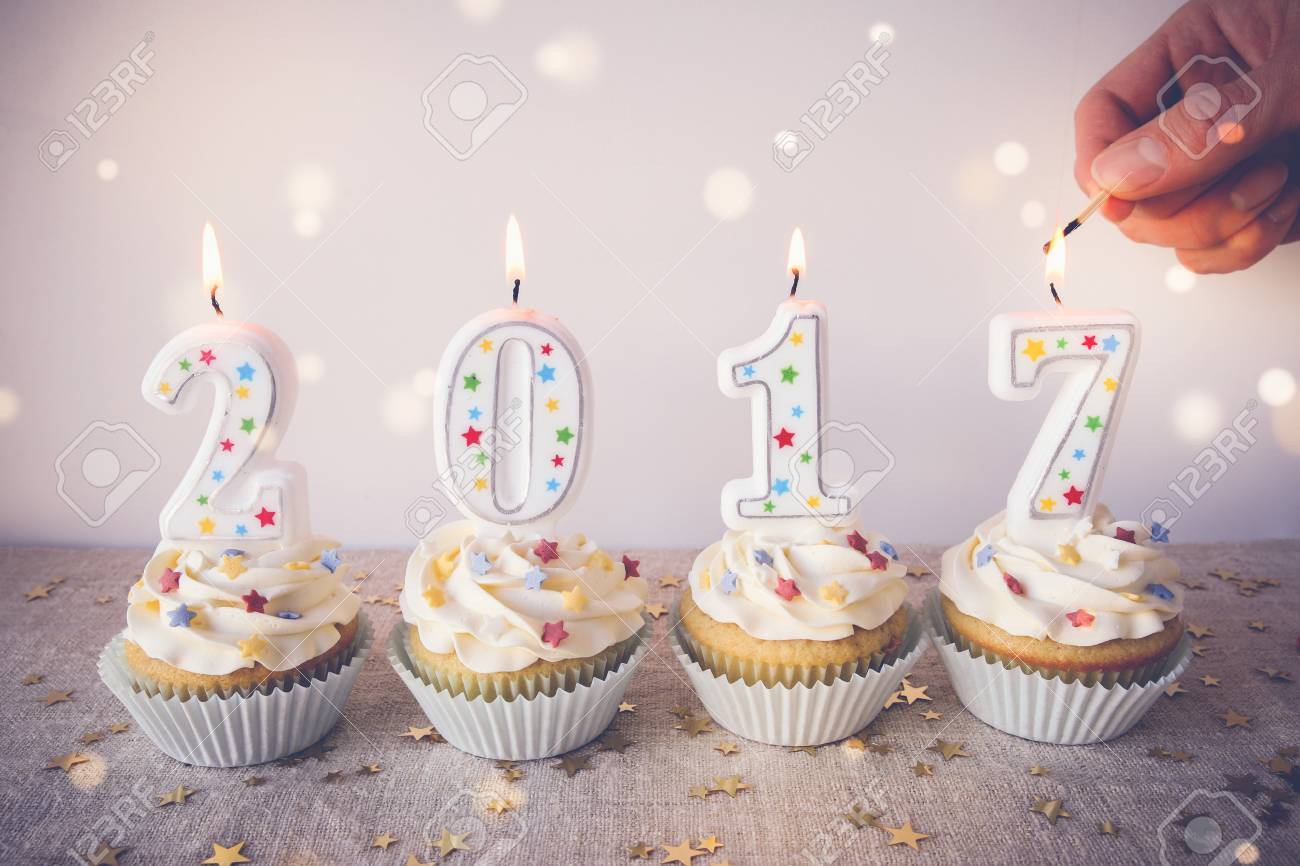2017 Happy New Year Cupcakes With Fairy Light Toning Background     2017 Happy New Year Cupcakes with fairy light toning background Stock Photo    69206441