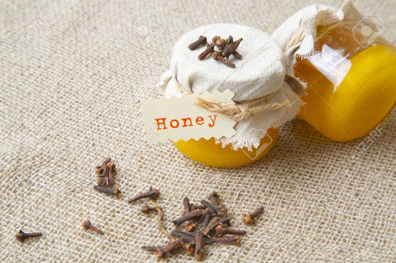 A Glass Of Cloves Honey. Cloves Buds In The Background Stock Photo, Picture  And Royalty Free Image. Image 44477889.