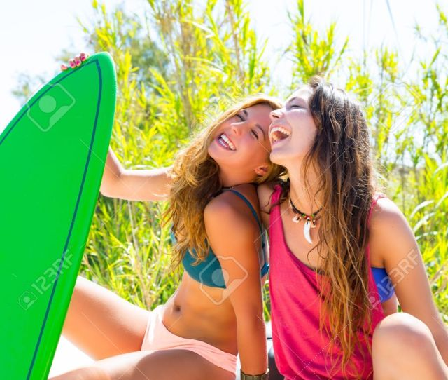 Happy Crazy Teen Surfer Girls Smiling On White Convertible Car Stock Photo