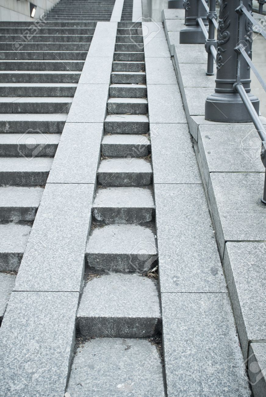 A Set Of Stone Steps In Germany With A Ramp For Wheelchairs And