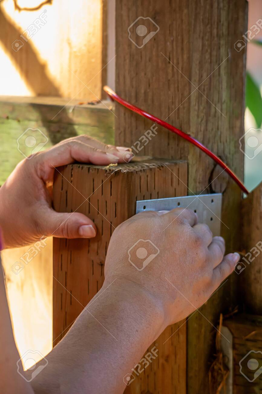 Woman S Hand Holding Fence Post With Support Bracket In Metal Stock Photo Picture And Royalty Free Image Image 135771063